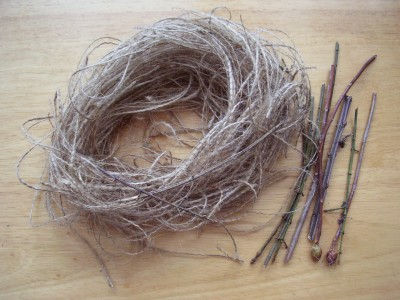 Bird nest craft with sticks and burlap fibers