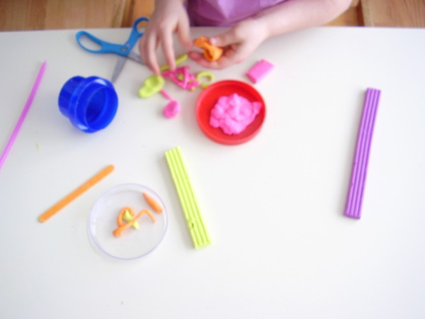 Cut and roll modeling clay for fine motor development