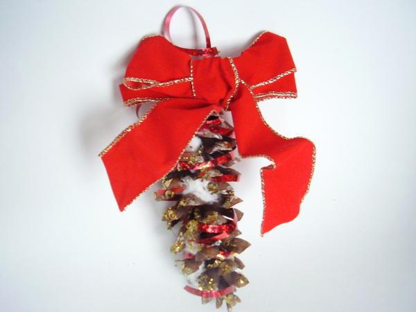 Decorate pine cones with glitter and bows