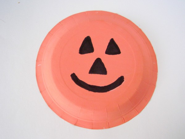 Paint a paper plate pumpkin with kids