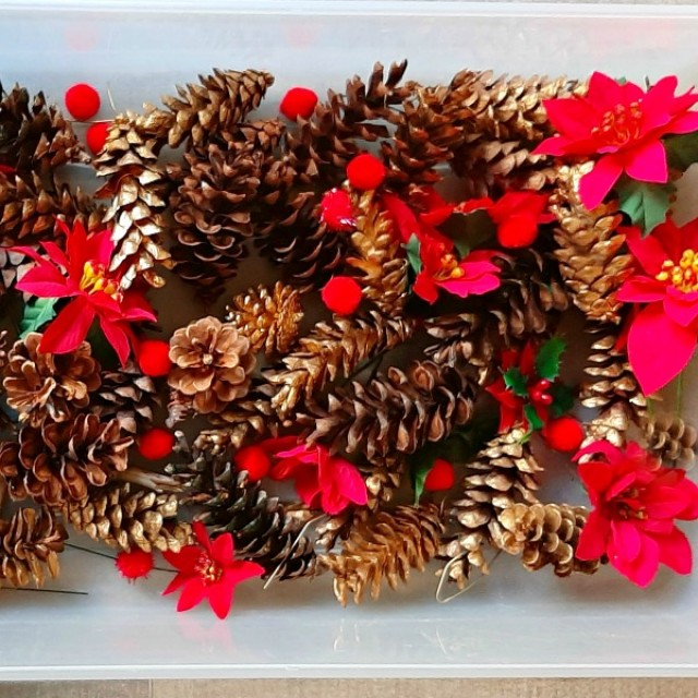 Christmas sensory bin with pine cones