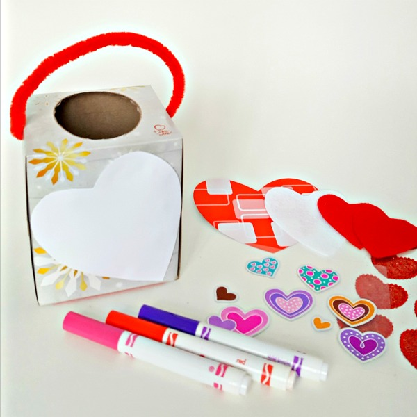Decorate Valentine mailboxes with markers and stickers