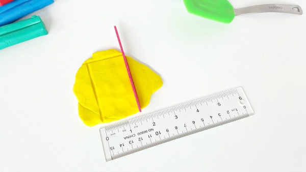 Draw shapes in clay with a craft stick