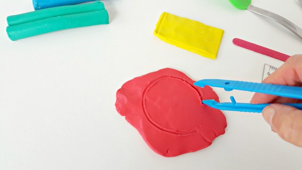 Draw shapes in clay with kids tongs or tweezers