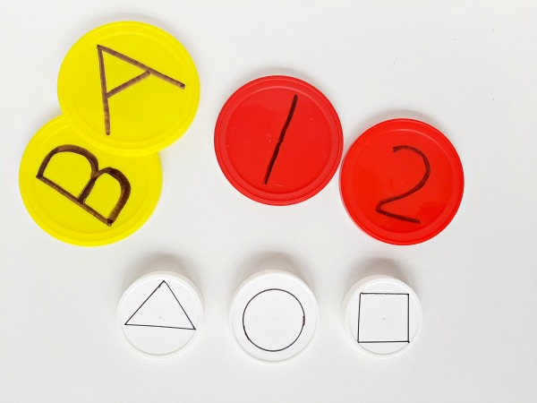 Label jar lids with letters numbers or shapes