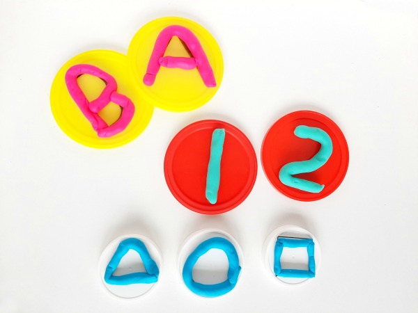 Make play dough mats with numbers or shapes from plastic lids