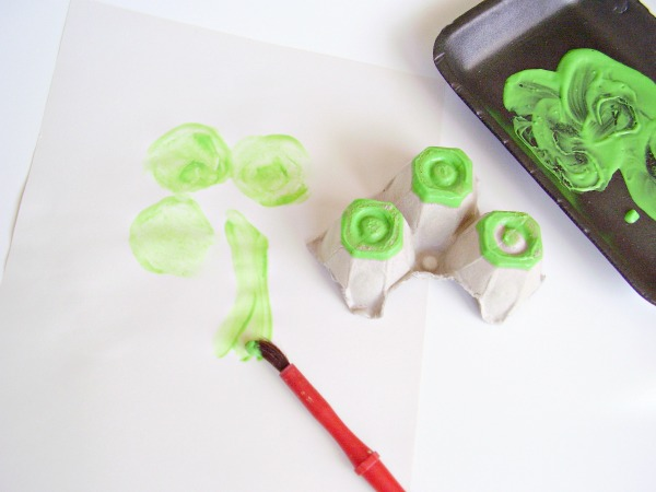 Paint a stem on shamrock painting with green paint