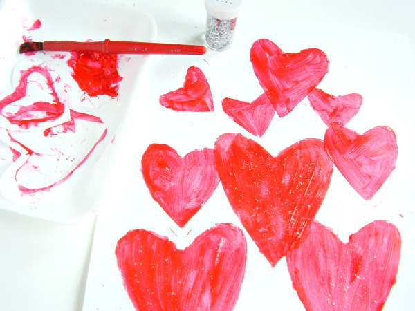 Paint with heart shaped stencils in different sizes