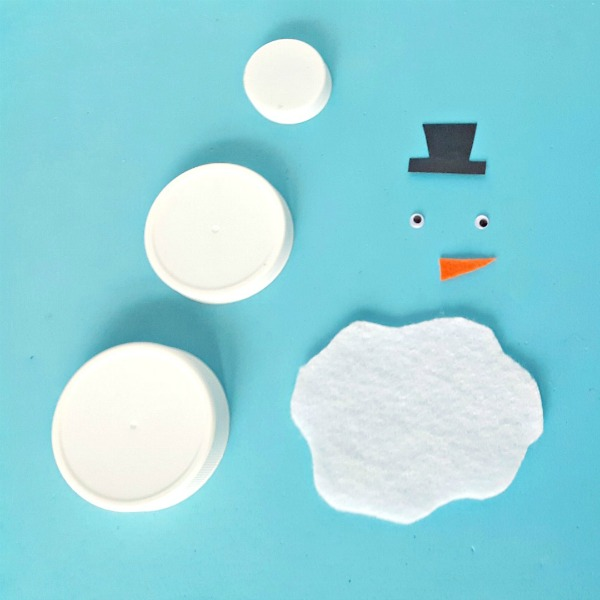 Supplies for a melting snowman craft