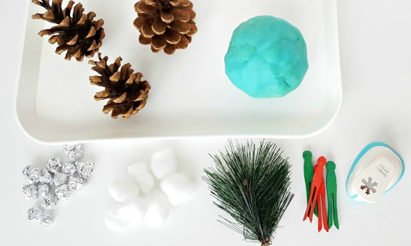 Supplies for a pine cone sensory tray activity