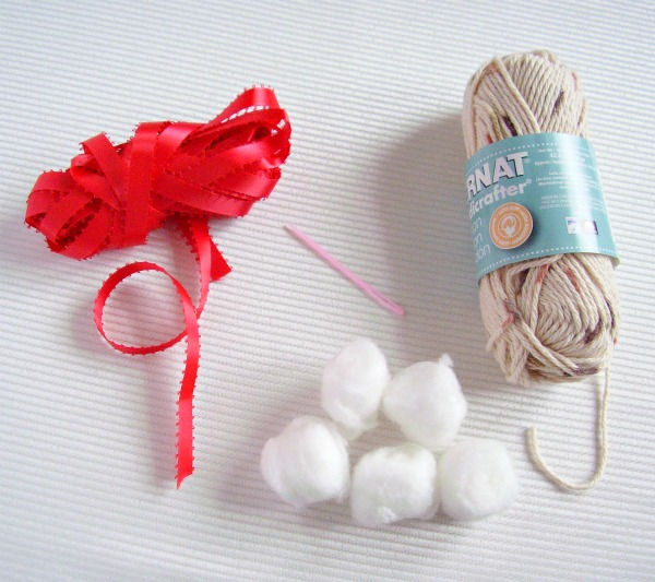 Supplies for a snowball ornament craft