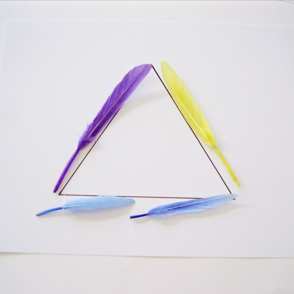 Triangle shape outlined with feathers in a math activity for kids