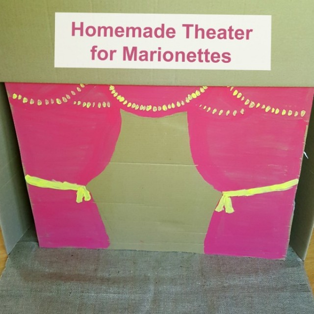 Cardboard box theater you can make for puppet shows with marionettes