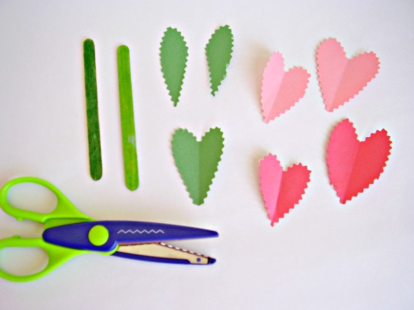 Cut paper with scalloped edge scissors to make petals and leaves