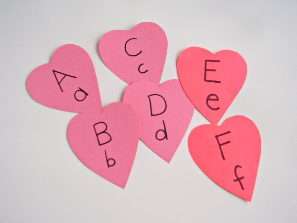 Cut valentine shapes from card stock to make alphabet cards for preschool literacy activities