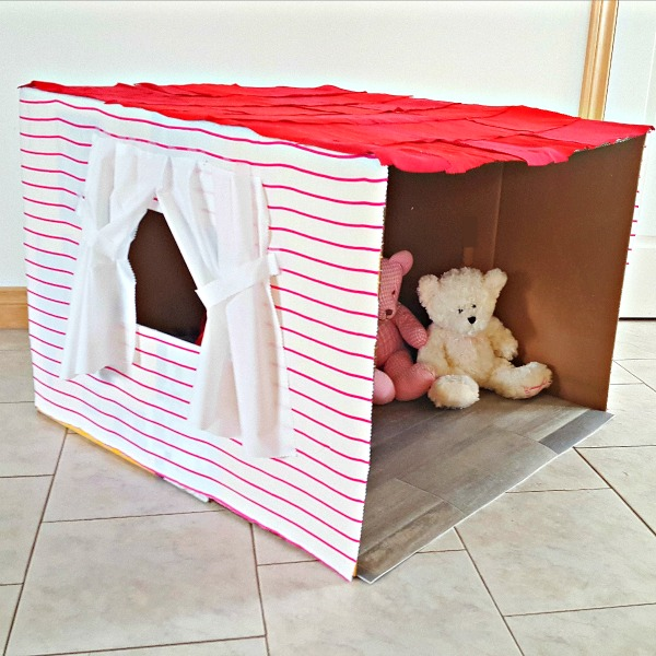 Homemade cardboard play house for kids