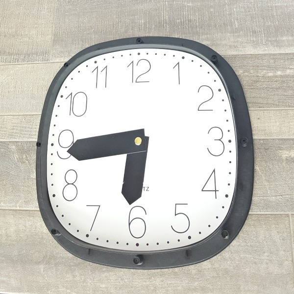 Early learning with DIY clock for telling time activities