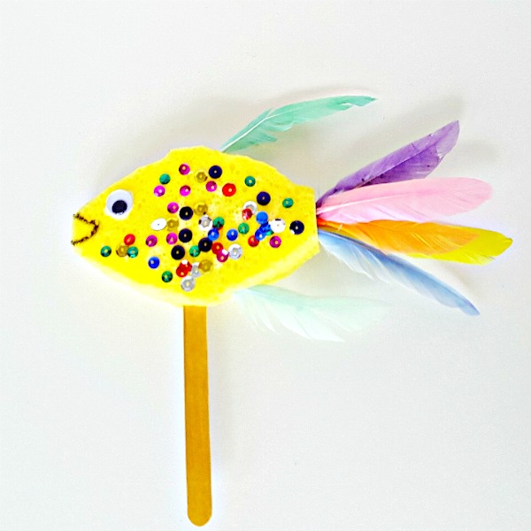 Fish puppet kids can make with a sponge and feathers