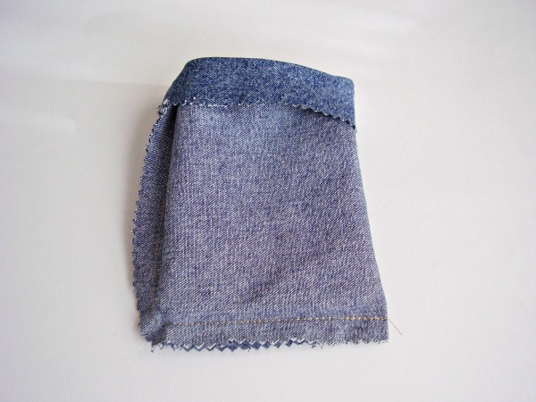 Fold denim over and stitch on two sides to make a bean bag