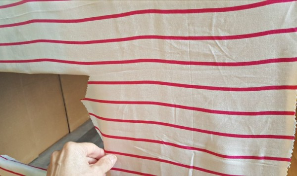Fold fabric to inside and tape to inside wall of kids play house
