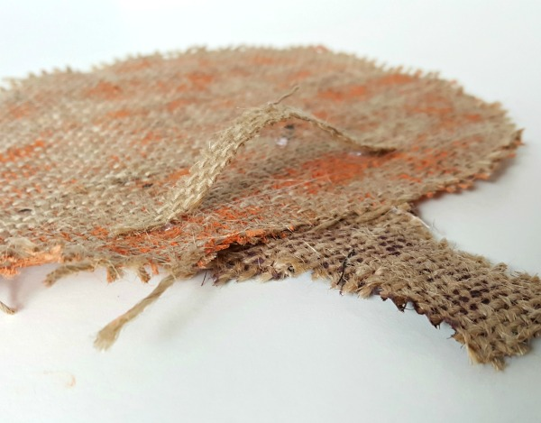 Glue a strip of burlap to the back of the jack o lantern craft for a hanger.