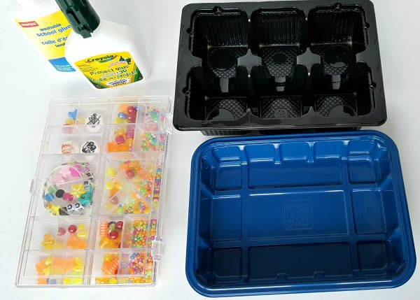 Supplies for a glue and beads science activity with preschoolers