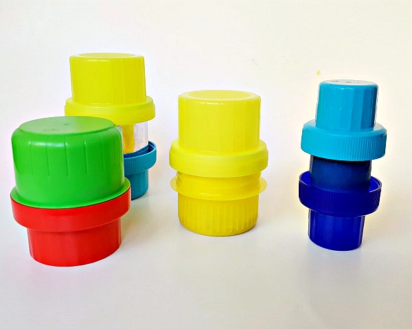 Glue or tape bottle lids together to make musical shakers