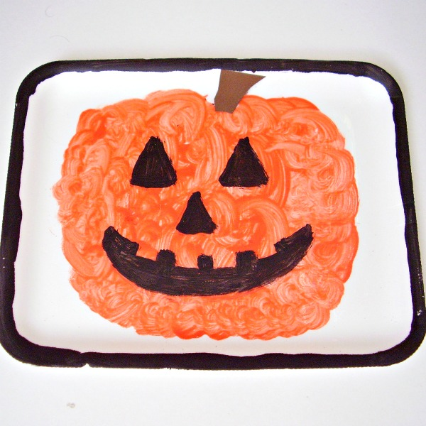 Kids can paint jack-o-lantern pictures on foam trays for Halloween decoration