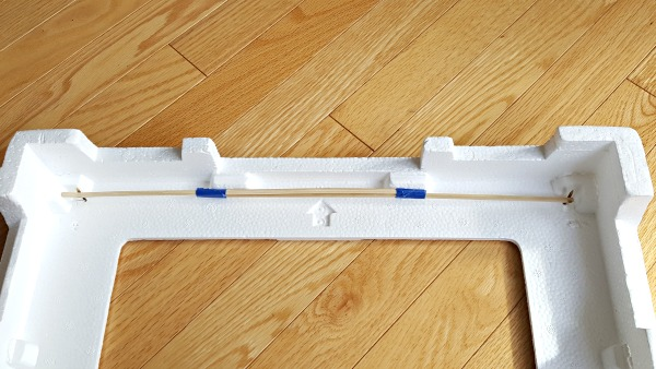 Make a curtain rod for the puppet theater