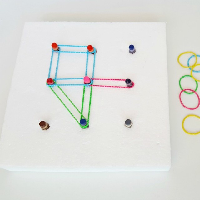 Make a geoboard with recycled crayons and elastics for preschool math activities