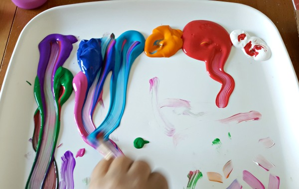 Mix paint colors with a paint brush preschool art activity