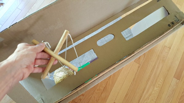 Operate marionette in a homemade puppet theater