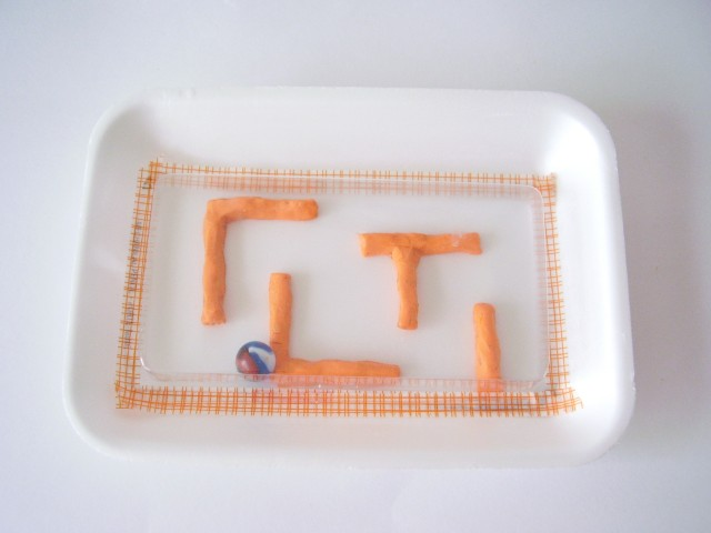 Marble maze for kids to make using modeling clay