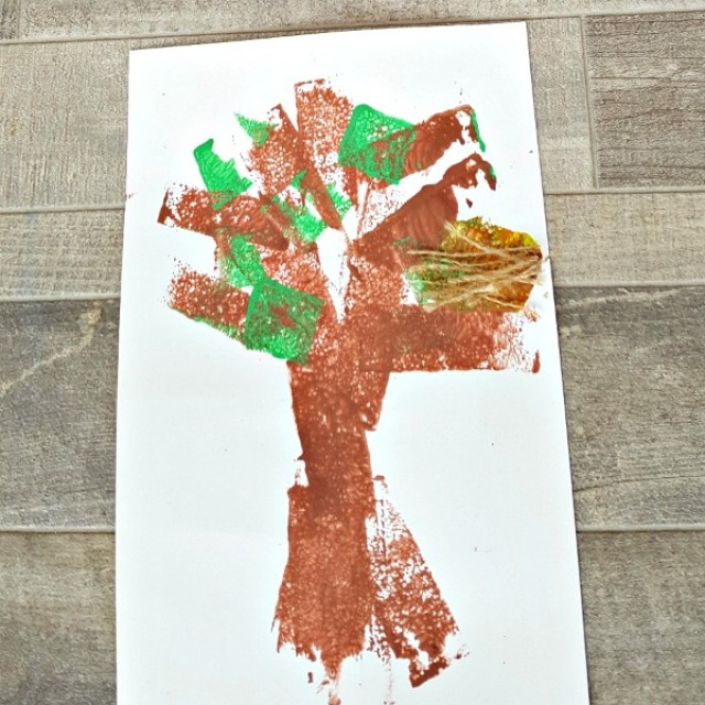 Painted tree with bird nest preschool craft for spring