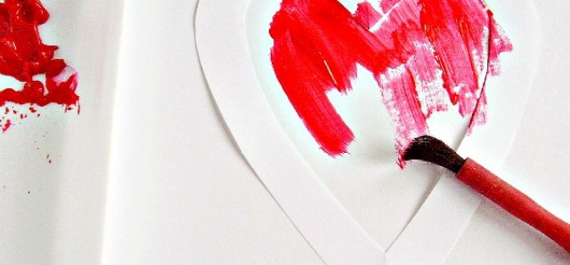 Painting with stencils in a Valentine themed activity for kids