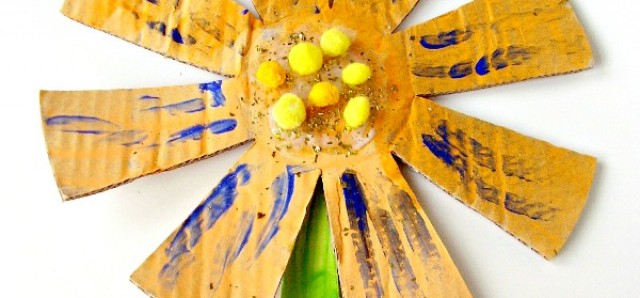 Preschool art activity painting big cardboard flowers