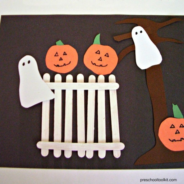 Pumpkins and ghosts on a craft stick fence Halloween art activity for preschoolers