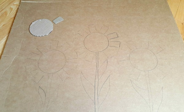 Sketch flowers on a cardboard screen for a backdrop