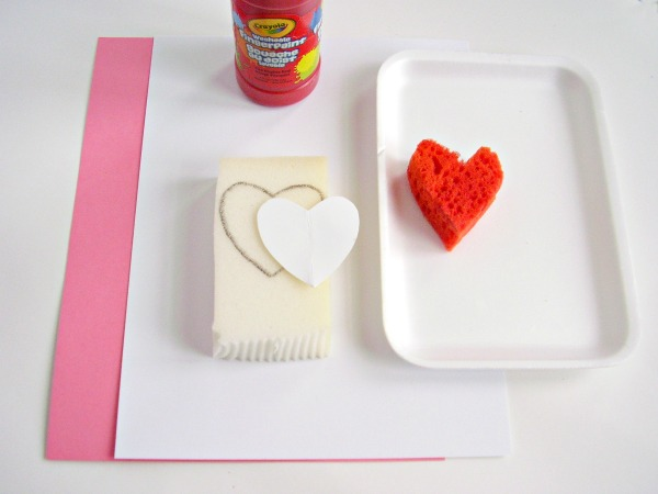 Supplies for a Valentine painting activity with kids
