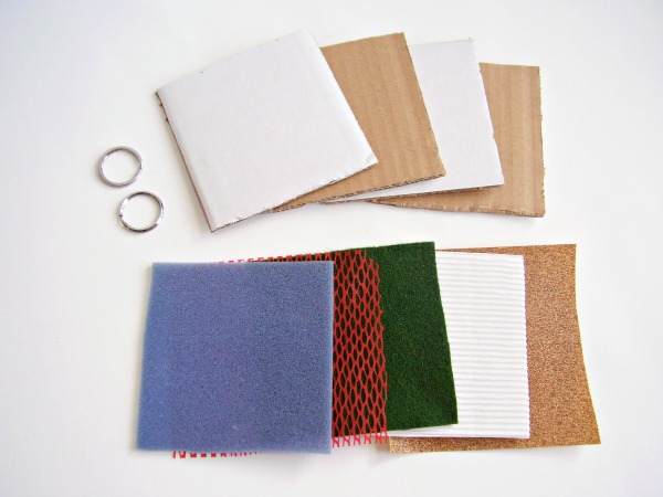 Supplies for a homemade sense of touch book for early learners