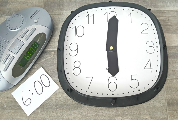 Use a digital and an analog clock in early learning activities