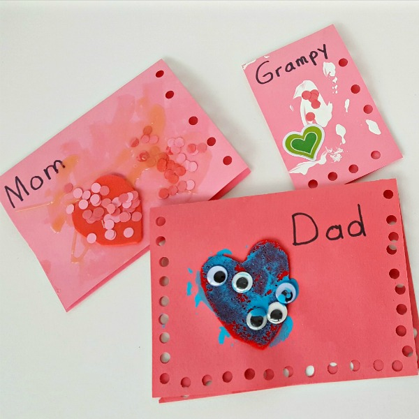 Valentine process art activity for kids using hole punch and glue
