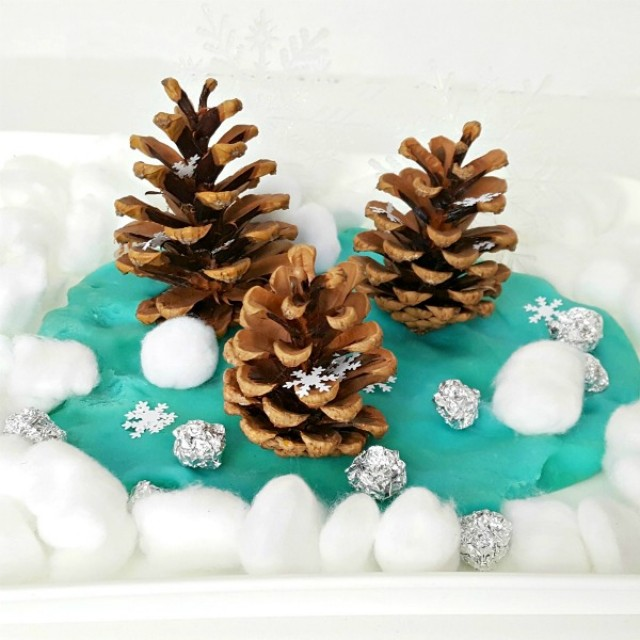 Winter sensory play with pine cones and play dough for toddlers and preschoolers