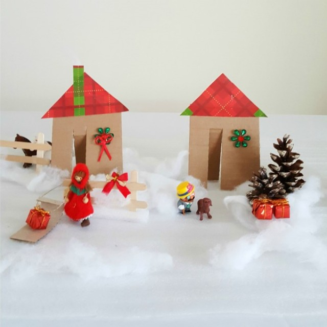 Winter small world play with cardboard houses and pine cone trees
