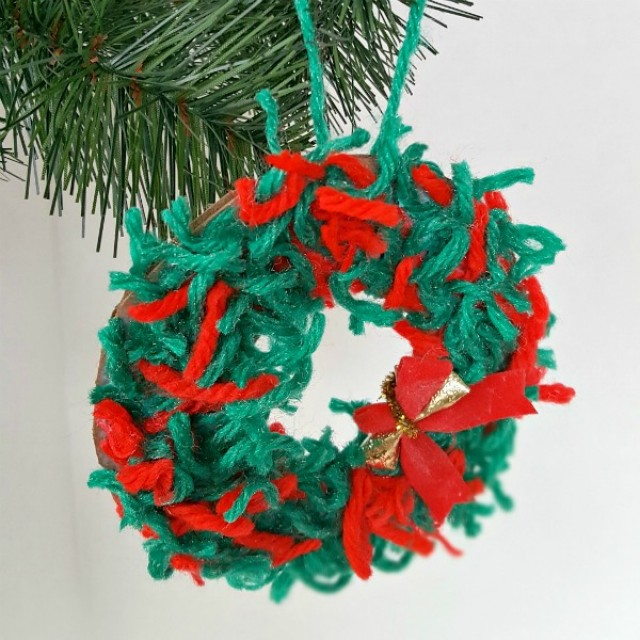 Yarn scraps wreath Christmas ornament craft for kids
