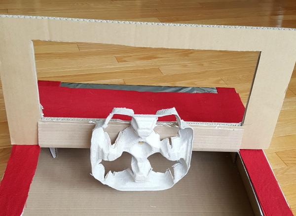 Add steering wheel to cardboard box car with paper fastener