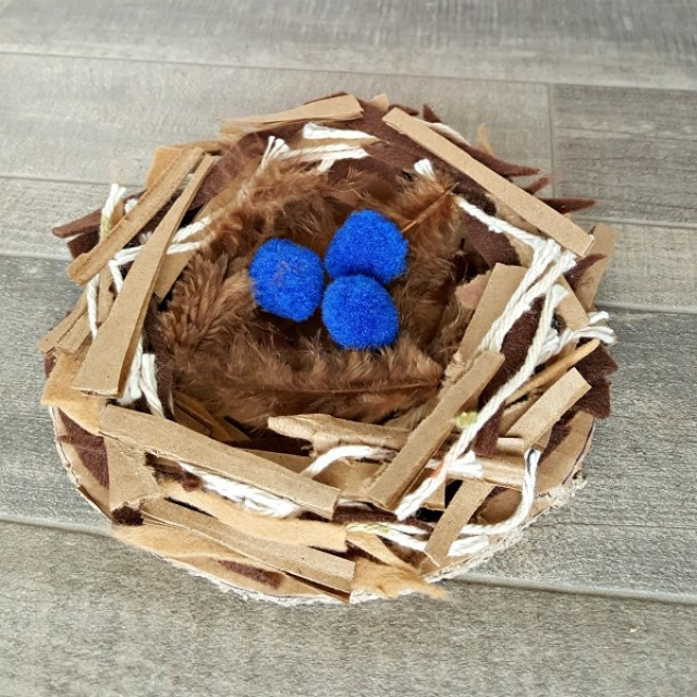 Bird nest preschool craft with mixed materials and pompoms