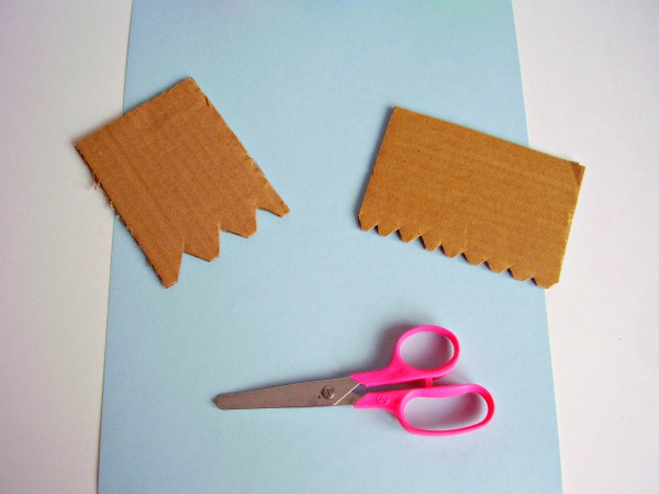 cut out cardboard shapes to make paint spreaders for kids activities
