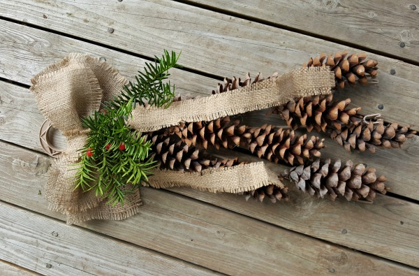 Homemade rustic decor with pine cones