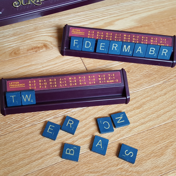 Literacy games with early learners using letters of the alphabet tiles